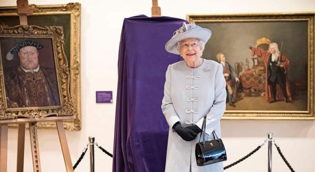 The Queen standing in front of King Henry the Eighth portrait