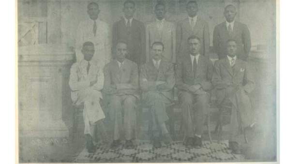 Black and white photograph of 10 men seated and standing for a form photograph