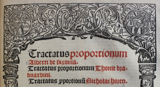 Woodcut border around a title page printed in red and black