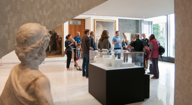 Visitors standing in the marble hall