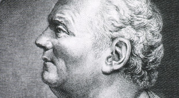 Black and white engraving of a man in profile, depicted as a classical bust