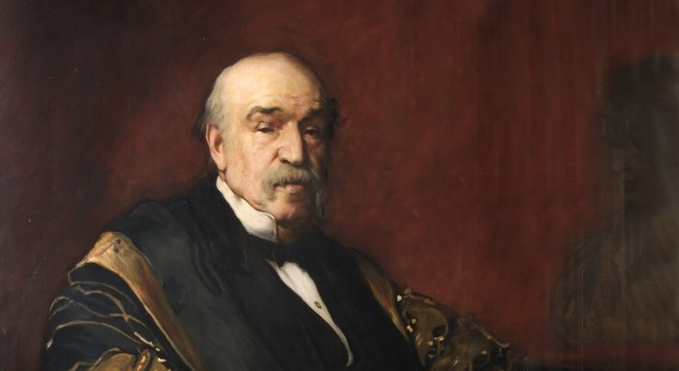 Oil paintings of a white man with a grey moustache seated, wearing black and gold ceremonial robes