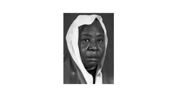 Black and white photograph of a black woman wearing a white headscarf