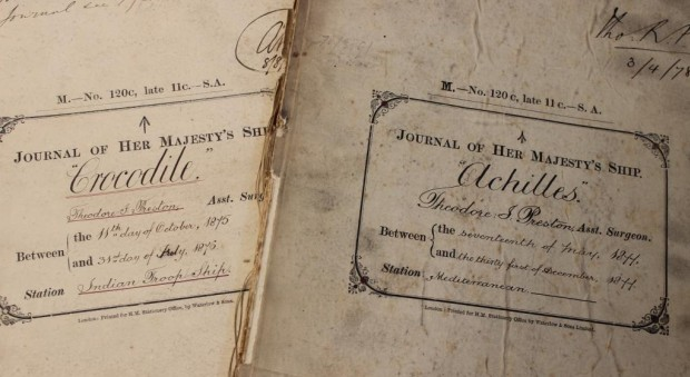 Photograph of the covers of handwritten journals, showing the ship names Crocodile and Achilles