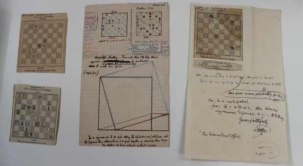 Handwritten notes on chess problems.