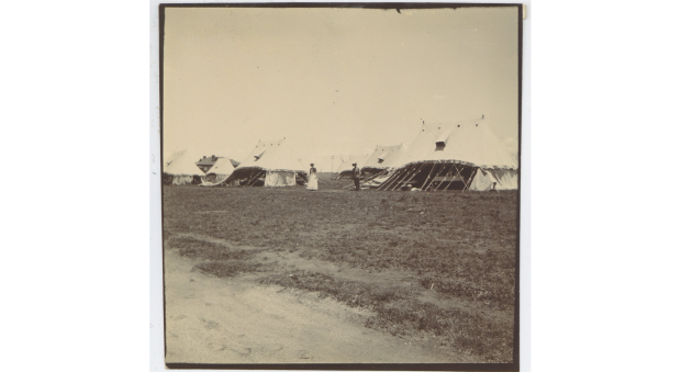 Black and white photograph of white field hospital tents