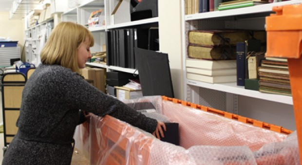 Image of the UK-MHL project coordinator packing a crate for the project