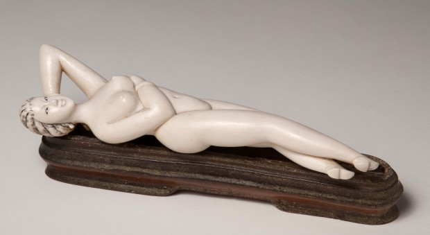Ivory model of a naked woman reclining.