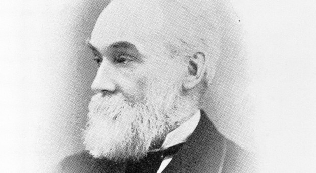Black and white photograph of a man with a full beard
