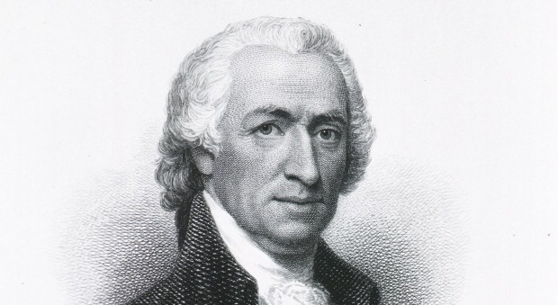 Black and white portrait of a man in an 18th century wig