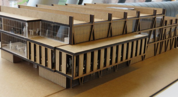 Photograph of a model of a building made in pale wood