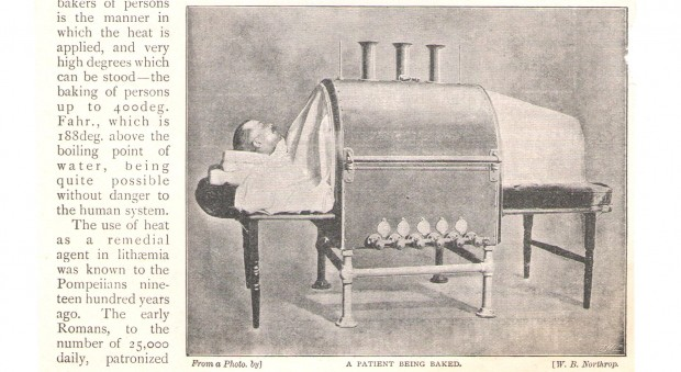 Black and white photograph showing a patient lying inside a large cylindrical device