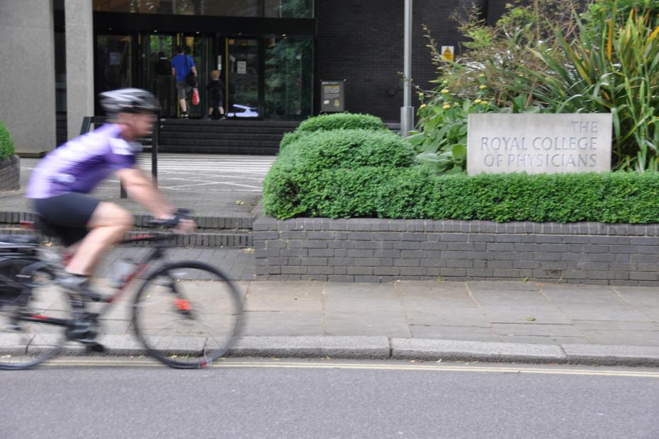 A cyclist rides past the RCP's headquarters in Regent's Park