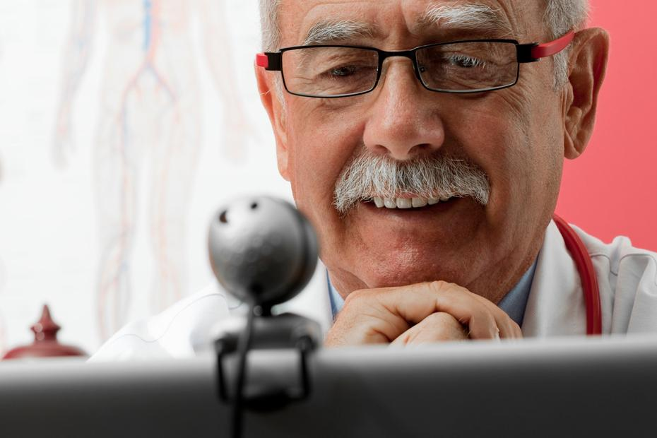 Image of a doctor watching a video