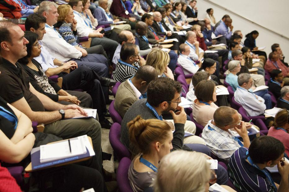 Delegates sitting in a full conference theatre