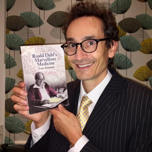 Professor Tom Solomon holding his new book, Roald Dahl's Marvellous Medicine