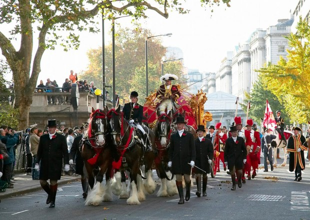 The golden carriage surrounded by the royal guard on horses