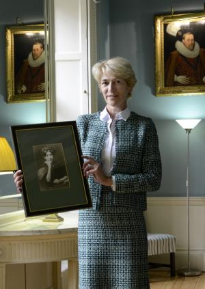 Professor Angela Thomas holding a photograph of Dr Isabella Pringle