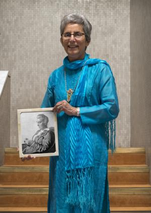 Professor Dame Parveen Kumar holding a photograph of Dr Jane Walker