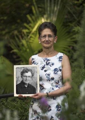 Professor Neena Modi holding a picture of Professor June Lloyd, Baroness Lloyd of Highbury