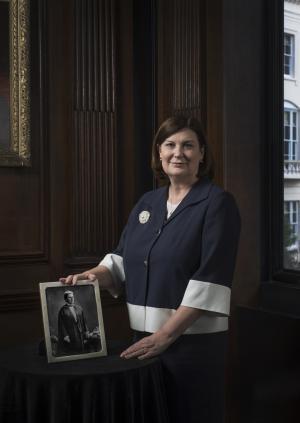 Professor Wendy Reid holding a picture of Dame Louisa Aldrich-Blake