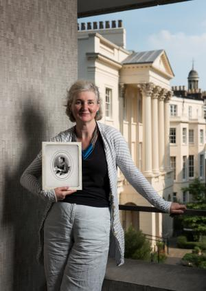 Dr Fiona Godlee holding a photograph of Dr Sophia Jex-Blake