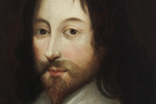 Portrait of a man in Elizabethan dress with pale skin, dark hair and a beard