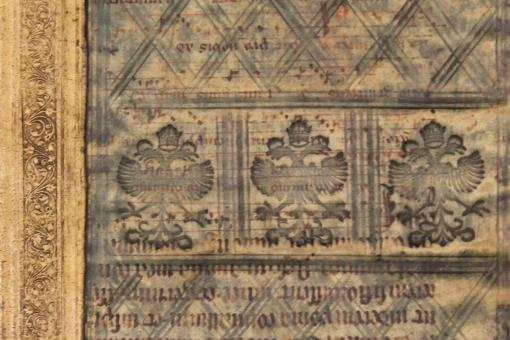 Detail of three double-headed eagles stamped into green-stained parchment