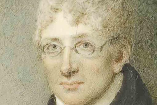 Colour portrait of James Curry, a man with white hair wearing glasses