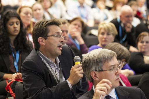 Participant in audience asking question