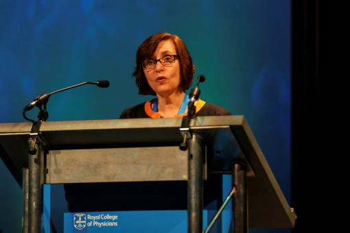 Professor Jane Dacre stands at a lectern while delivering a speech