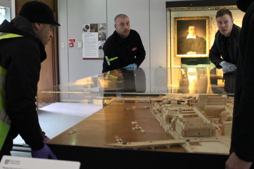 Architectural model being removed from the First Floor Gallery