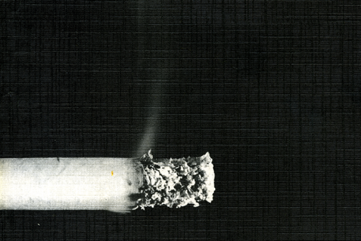 Black and white cover of the RCP report, showing a smouldering cigarette