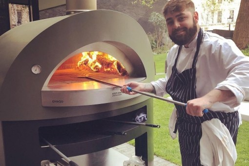 Man using pizza oven