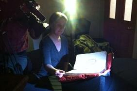 Rare Books and Special Collections Librarian Katie Birkwood being filmed for a documentary by EBS