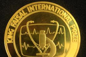 Gold medal inscribed 'King Faisal International Prize for Medicine', showing an ECG trace, a stethoscope and a microscope.
