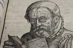 Man wearing glasses and reading from Georg Bartisch, Ophthalmodouleia (1583)