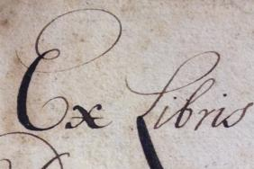 Elaborate gift inscription on the flyleaf of an early book: Ex libris mihi datis Ab Amplissimo et Doctissimo Hieronimo Vennesio