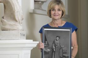 Professor Eilis McGovern holding a photograph of Dr Emily Winifred Dickson