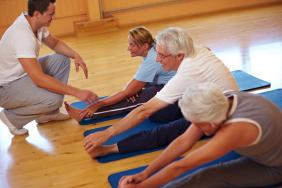 People stretching in an exercise class