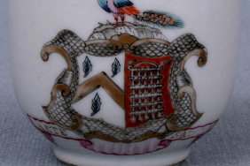 A Chinese hard paste porcelain cup decorated with a 'spearhead' border in red and gold and an armorial, c.1760. David Sanctuary Howard collection of coffee cups at the Reeves Center, Washington and Lee University, Virginia.