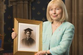 Professor Dame Anna Dominiczak holding a photograph of Dr Marion Gilchrist