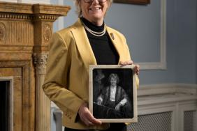 Professor Dame Sally Davies holding a picture of Margaret Turner-Warwick