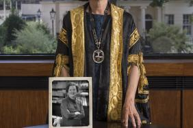 Professor Jane Dacre holding a picture of Dame Sheila Sherlock