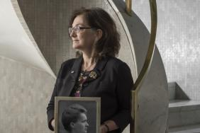 Professor Joanna Wardlaw holding a photograph of Marie Curie