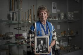 Professor Lesley Regan holding a picture of Dame Hilda Lloyd