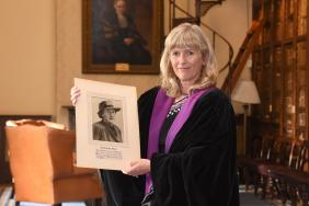 Professor Mary Horgan holding a picture of Dr Dorothy Stopford Price