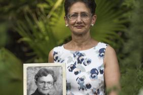 Professor Neena Modi holding a picture of Professor June Lloyd, Baroness Lloyd of Highbury