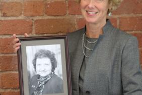 Professor Sheona MacLeod holding a picture of Dr Vicky Osgood