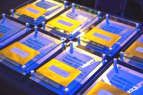 Gold winners' envelopes placed on top of commemorative plaques given out at the 2017 awards
